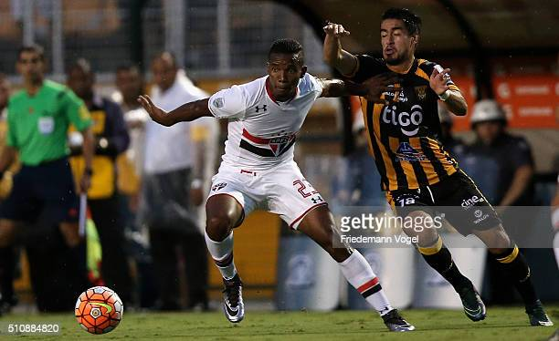 Thiago Mendes of Sao Paulo fights for the ball with Rodrigo Ramallo of The Strongest during a match between Sao Paulo v The Strongest as part of...