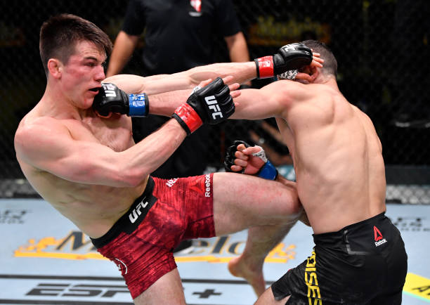 Thiago Moises of Brazil and Alexander Hernandez trade strikes in a lightweight bout during the UFC Fight Night event at UFC APEX on February 27, 2021...