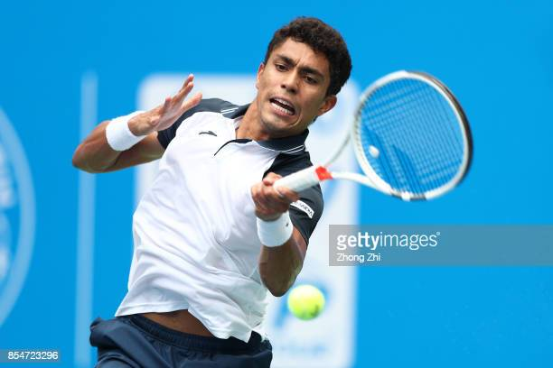 Thiago Monteiro of Brazil returns a shot during the match against Yuichi Sugita of Japan during Day 3 of 2017 ATP Chengdu Open at Sichuan...