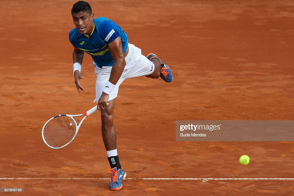 Thiago Monteiro of Brazil returns a shot to Pablo Cuevas of Uruguay during the ATP Rio Open 2018 at Jockey Club Brasileiro on February 20, 2018 in Rio de Janeiro, Brazil.