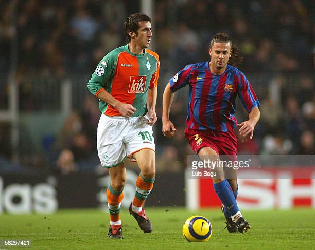 Thiago Motta of Barcelona and Johan Micaud of Werder Bremen in action during the UEFA Champions League Group C match between FC Barcelona and Werder...