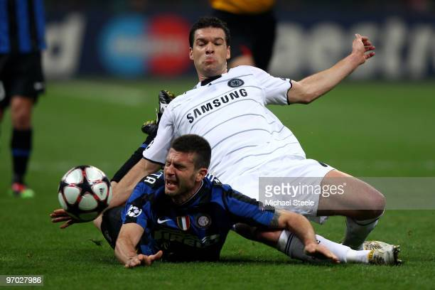 Thiago Motta of Inter Milan is brought down by Michael Ballack of Chelsea during the UEFA Champions League Round of 16 first leg match between Inter...