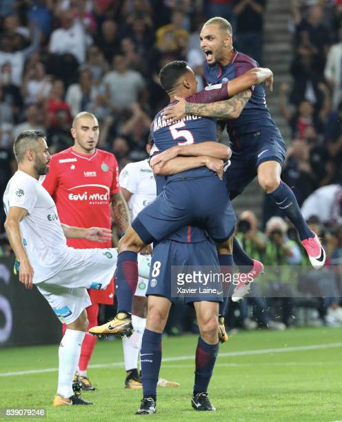 Thiago Motta of Paris SaintGermain celebrate his goal with Marquinhos Layvin Kurzawa and during the French Ligue 1 match between Paris Saint Germain...