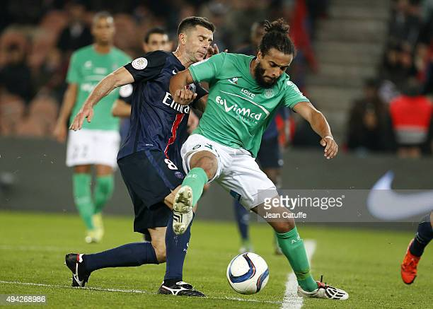 Thiago Motta of PSG and Benoit AssouEkotto of SaintEtienne in action during the French Ligue 1 match between Paris SaintGermain and AS SaintEtienne...