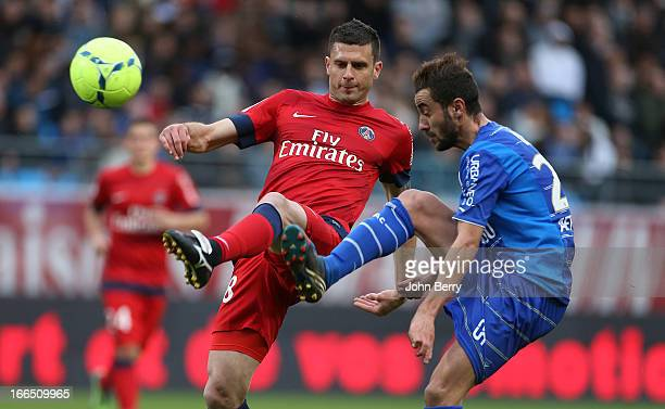 Thiago Motta of PSG and Fabien Camus of Troyes in action during the Ligue 1 match between ES Troyes Aube Champagne ESTAC and Paris SaintGermain FC...