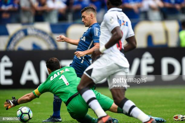 Thiago Neves of Cruzeiro and Martin Silva of Vasco da Gama battle for the ball during a match between Cruzeiro and Vasco da Gama as part of...