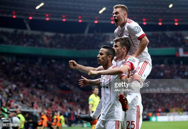 Thiago of Bayern celebrates after he scores the 4th goal during the DFB Cup semi final match between Bayer 04 Leverkusen and Bayern Munchen at...