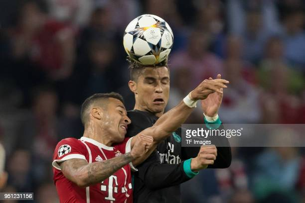 Thiago of Bayern Muenchen and Cristiano Ronaldo of Real Madrid battle for the ball during the UEFA Champions League Semi Final First Leg match...