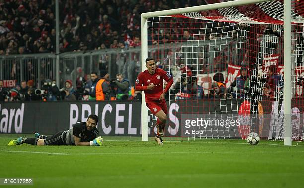 Thiago of Bayern Muenchen celebrates his goal as goalkeeper Gianluigi Buffon of Juventus Turin reacts during the Champions League round of 16 second...