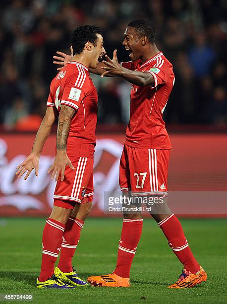 Thiago of Bayern Muenchen celebrates scoring their second goal with team-mate David Alaba during the FIFA Club World Cup Final match between Bayern...