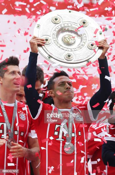 Thiago of Bayern Muenchen celebrates with the trophy following the Bundesliga match between Bayern Muenchen and SC Freiburg at Allianz Arena on May...