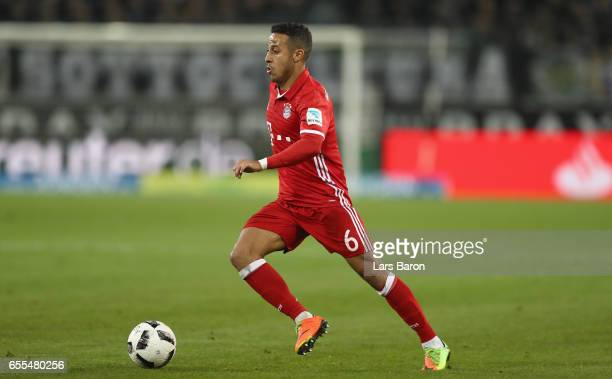Thiago of Bayern Muenchen runs with the ball during the Bundesliga match between Borussia Moenchengladbach and Bayern Muenchen at BorussiaPark on...
