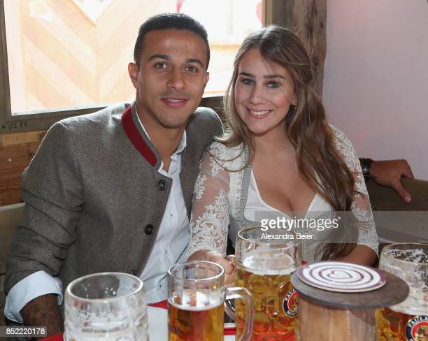 Thiago of FC Bayern Muenchen and his wife Julia Vigas attend the Oktoberfest beer festival at Kaefer Wiesenschaenke tent at Theresienwiese on...