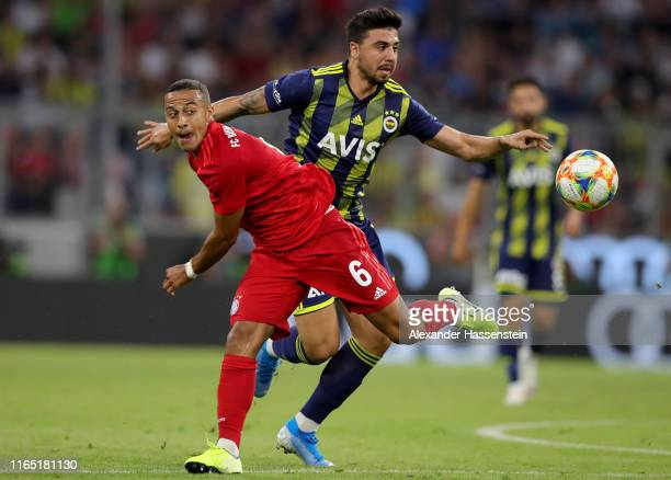 Thiago of FC Bayern Muenchen and Ozan Tufan of Fenerbahce fight for the ball during the Audi cup 2019 semi final match between FC Bayern Muenchen and...