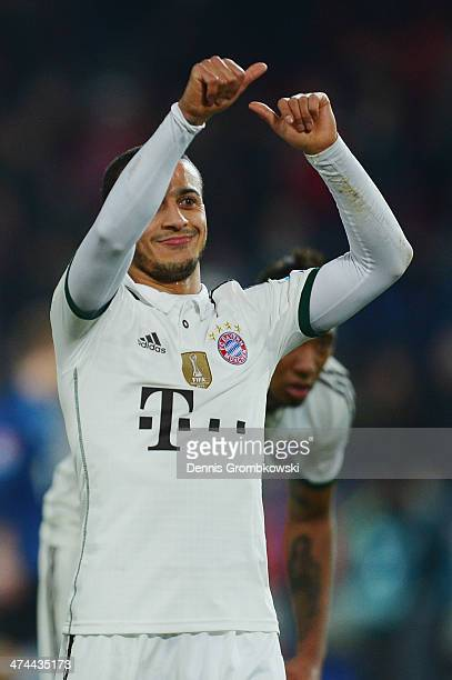 Thiago of FC Bayern Muenchen celebrates after the Bundesliga match between Hannover 96 and FC Bayern Muenchen at HDI-Arena on February 23, 2014 in...