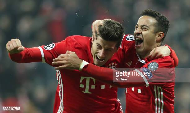 Thiago of FC Bayern Muenchen celebrates his first goal with teammate Robert Lewandowski during the UEFA Champions League Round of 16 first leg match...