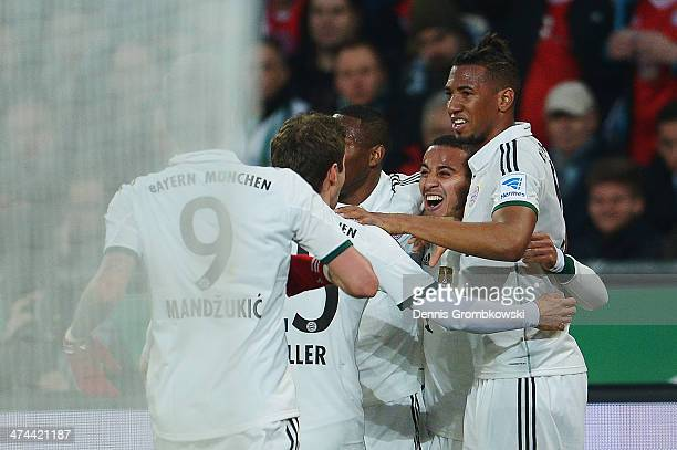 Thiago of FC Bayern Muenchen celebrates with teammates after scoring his team's second goal during the Bundesliga match between Hannover 96 and FC...