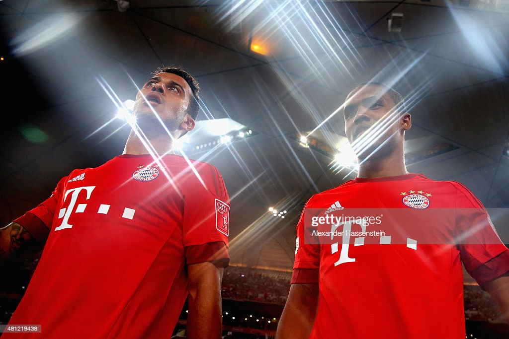 Thiago of FC Bayern Muenchen enters the field with his team mate Douglas Costa (R) for the international friendly match between FC Bayern Muenchen and Valencia FC of the Audi Football Summit 2015 at National Stadium on July 18, 2015 in Beijing, China.