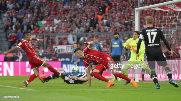 Thiago of FC Bayern Muenchen scores his first goal against goalkeeper Yann Sommer of Moenchengladbach during the Bundesliga match between FC Bayern...
