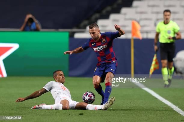 Thiago of FC Bayern Munich tackles Jordi Alba of FC Barcelona during the UEFA Champions League Quarter Final match between Barcelona and Bayern...