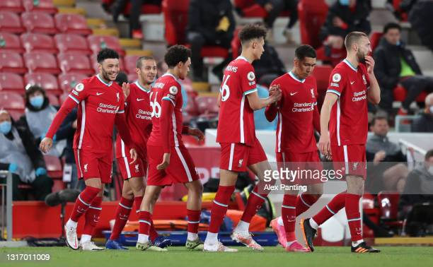 Thiago of Liverpool celebrates with Alex Oxlade-Chamberlain after scoring their side's second goal during the Premier League match between Liverpool...