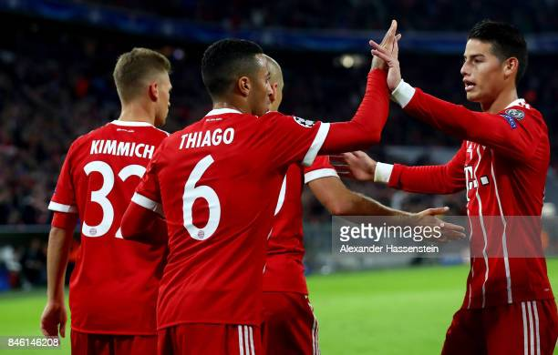 Thiago of Muenchen celebrate with team mate Joshua Kimmich after he scores the 2nd goal during the UEFA Champions League group B match between Bayern...