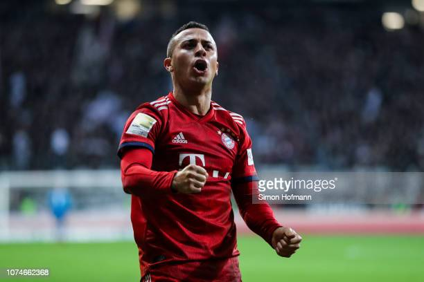 Thiago of Muenchen celebrates his team's third goal during the Bundesliga match between Eintracht Frankfurt and FC Bayern Muenchen at...