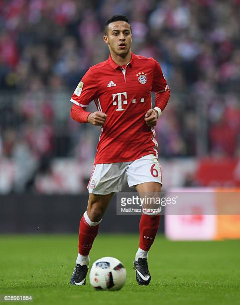 Thiago of Muenchen controls the ball during the Bundesliga match between Bayern Muenchen and VfL Wolfsburg at Allianz Arena on December 10 2016 in...