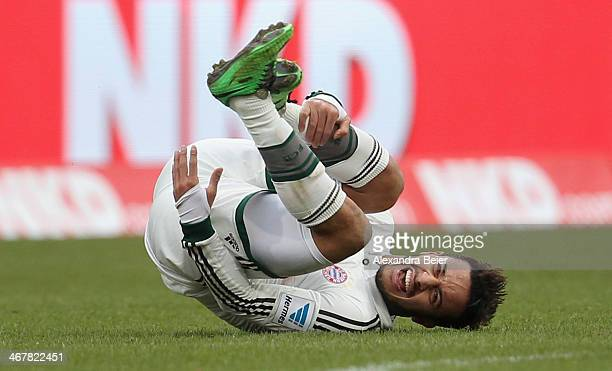 Thiago of Muenchen falls during the Bundesliga match between 1. FC Nuernberg and FC Bayern Muenchen at Grundig Stadium on February 8, 2014 in...