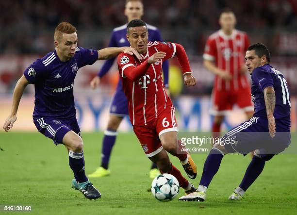 Thiago of Muenchen is challenged by Adrien Trebel of RSC Anderlecht and Nicolae Stanciu of RSC Anderlecht during the UEFA Champions League group B...