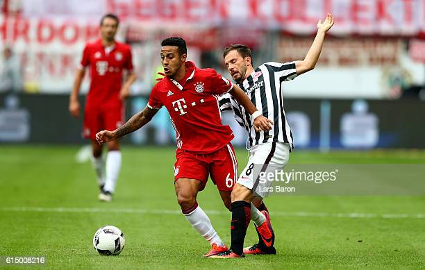 Thiago of Muenchen is challenged by Szabolcs Huszti of Eintracht Frankfurt during the Bundesliga match between Eintracht Frankfurt and Bayern...