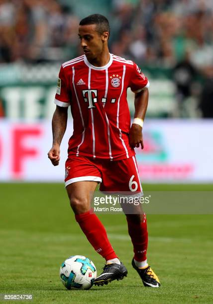 Thiago of Muenchen runs with the ball during the Bundesliga match between SV Werder Bremen and FC Bayern Muenchen at Weserstadion on August 26 2017...
