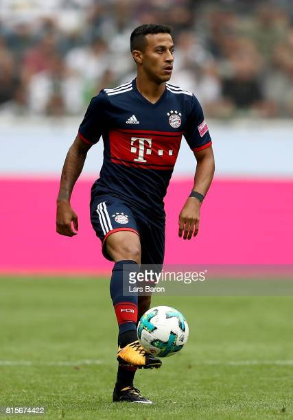 Thiago of Muenchen runs with the ball during the Telekom Cup 2017 match between Bayern Muenchen and 1899 Hoffenheim at on July 15 2017 in...
