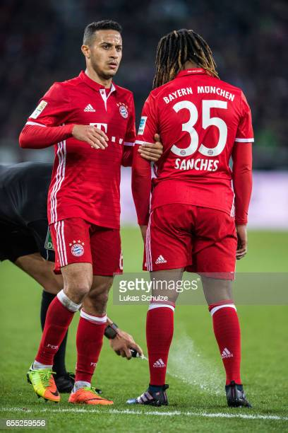 Thiago of Munich and Renato Sanches of Munich stay together during the Bundesliga match between Borussia Moenchengladbach and Bayern Muenchen at...