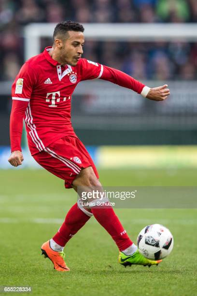 Thiago of Munich in action during the Bundesliga match between Borussia Moenchengladbach and Bayern Muenchen at BorussiaPark on March 19 2017 in...