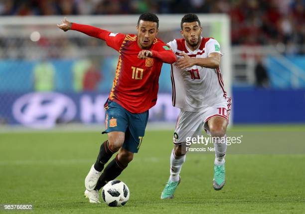 Thiago of Spain battles for possession with Younes Belhanda of Morocco during the 2018 FIFA World Cup Russia group B match between Spain and Morocco...