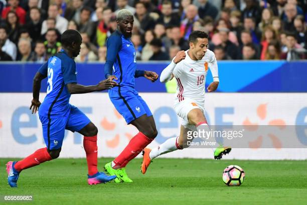 Thiago of Spain beats Tiemoue Bakayoko and Ngolo Kante of France during the friendly match between France and Spain at Stade de France on March 28...