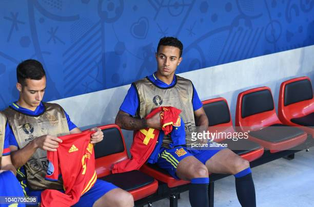Thiago of Spain sits at the substitutes bench before the Group D soccer match of the UEFA EURO 2016 between Spain and Turkey Stade de Nice in Nice,...