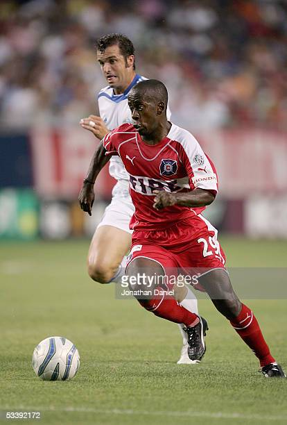 Thiago of the Chicago Fire plays the ball against Chris Klein of the Kansas City Wizards during their MLS match on August 10 2005 at Soldier Field in...