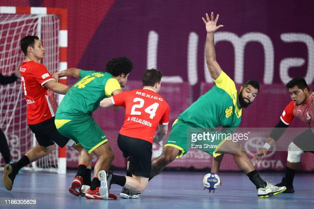 Thiago Ponciano of Brazil blocks a shot from Abiel Villalobos of Mexico in Men`s Handball Bronze Medal Match between Brazil and Mexico on Day 10 of...