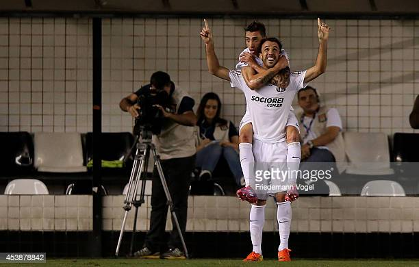 Thiago Ribeiro of Santos celebrates scoring the first goal with Rildo during the match between Santos and Atletico PR for the Brazilian Series A 2014...