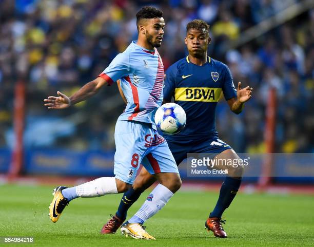 Thiago Rodrigues Da Silva of Arsenal fights for ball with Wilmar Barrios of Boca Juniors during a match between Boca Juniors and Arsenal as part of...