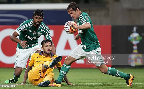 Thiago Santos and Lucas of Palmeiras fights for the ball with Gustavo Colman of Rosario during a match between Palmeiras and Rosario as part of Group...