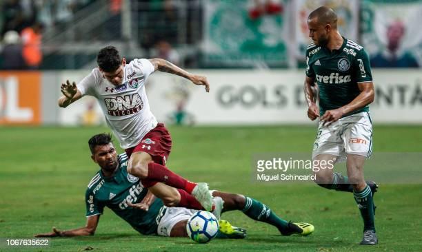 Thiago Santos and Mayke of Palmeiras compete for the ball with Ayrton Lucas of Fluminense during a match between Palmeiras and Fluminense for the...