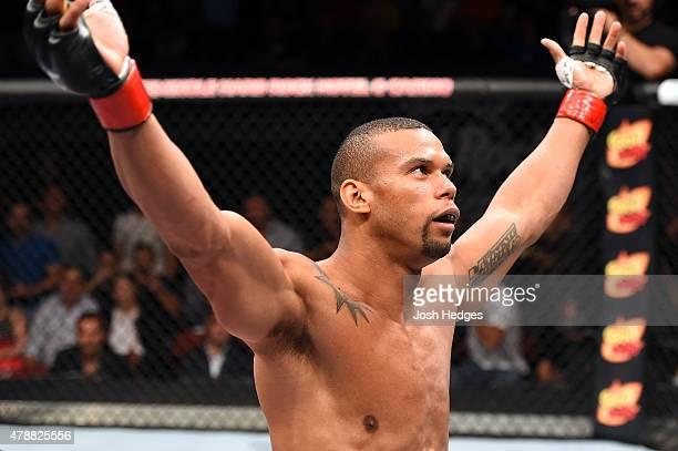Thiago Santos of Brazil celebrates after defeating Steve Bosse of Canada in their middleweight during the UFC Fight Night event at the Hard Rock Live...