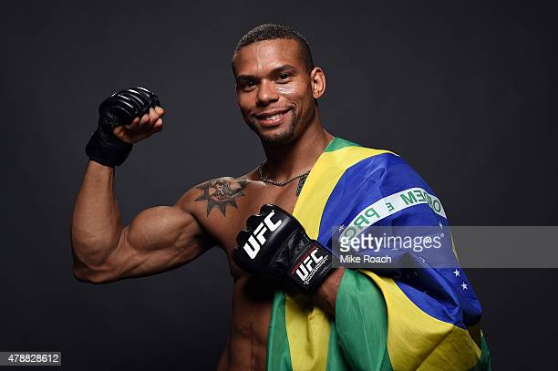 Thiago Santos of Brazil poses for a postfight portrait backstage during the UFC Fight Night event at the Hard Rock Live on June 27 2015 in Hollywood...