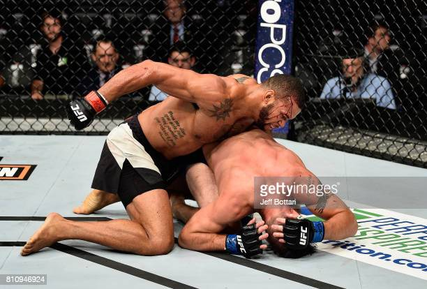Thiago Santos of Brazil punches Gerald Meerschaert in their middleweight bout during the UFC 213 event at TMobile Arena on July 8 2017 in Las Vegas...