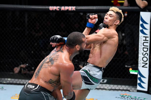 Thiago Santos of Brazil punches Johnny Walker of Brazil in their light heavyweight bout during the UFC Fight Night event at UFC APEX on October 02,...