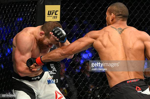 Thiago Santos of Brazil punches Nate Marquardt in their middleweight bout during the UFC 198 event at Arena da Baixada stadium on May 14, 2016 in...