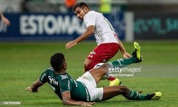 Thiago Santos of Palmeiras vies the ball with Sornoza of Fluminense during a match between Palmeiras and Fluminense for the Brasileirao Series A 2018...
